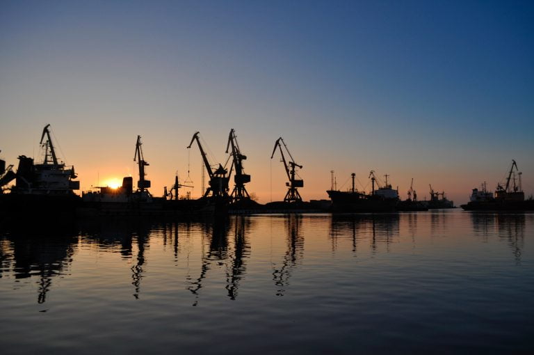 Cargo cranes in the dock of Industrial Port on sunrise