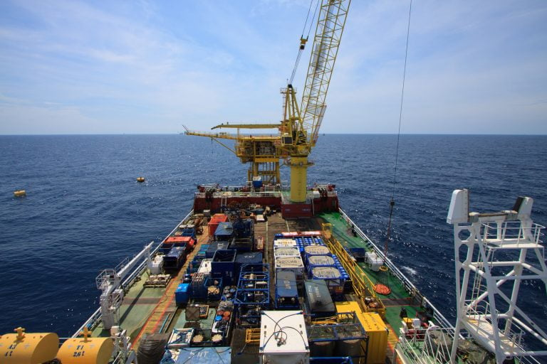 Large crane vessel installing the platform in offshore